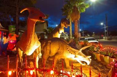 A view of Steve Springer's prehistoric front yard that was decorated in October in a Halloween theme.