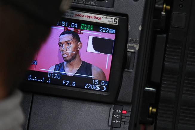 UNLV forward Mike Moser is seen on the display of a TV camera while giving an interview after the Rebels first official practice Friday, Oct. 12, 2012.