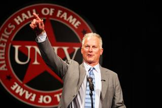 Kenny Mayne accepts the Silver Rebel Award during the UNLV Athletics Hall of Fame Ceremony at the South Point Casino on Friday, October 12, 2012.