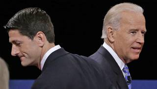 Republican vice presidential nominee Rep. Paul Ryan of Wisconsin and Vice President Joe Biden pass each other after the vice presidential debate at Centre College, Thursday, Oct. 11, 2012, in Danville, Ky.