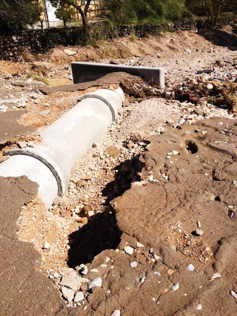 "Heavy rains on Thursday evening damaged a drainage structure on Placid Street just south of Windmill Lane in the southern valley. Water rushing through a wash in the area also damaged the roadway, prompting the closure of Placid. ""The water came up to the middle of my front yard,"" said Ron Falahi, who lives on the edge of the wash."
