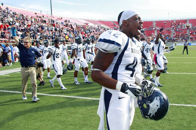 UNR linebacker DeAndre Boughton celebrates as time expires in their game against UNLV Saturday, Oct. 13, 2012 at Sam Boyd Stadium. UNR came from behind and won the game, for the eighth consecutive time, 42-37.