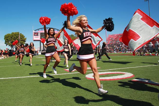 UNLV cheerleaders lead the team out for their game against UNR Saturday, Oct. 13, 2012 at Sam Boyd Stadium. UNR came from behind and won the game, for the eighth consecutive time, 42-37.