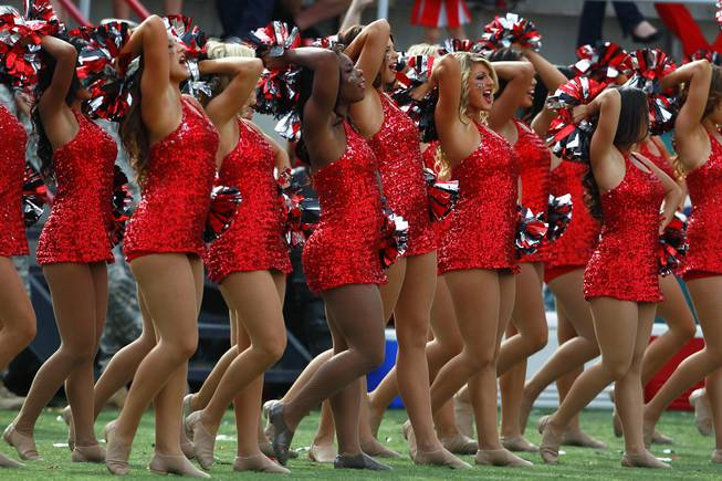 UNLV cheerleaders perform during their game against UNR Saturday, Oct. 13, 2012 at Sam Boyd Stadium. UNR came from behind and won the game, for the eighth consecutive time, 42-37.