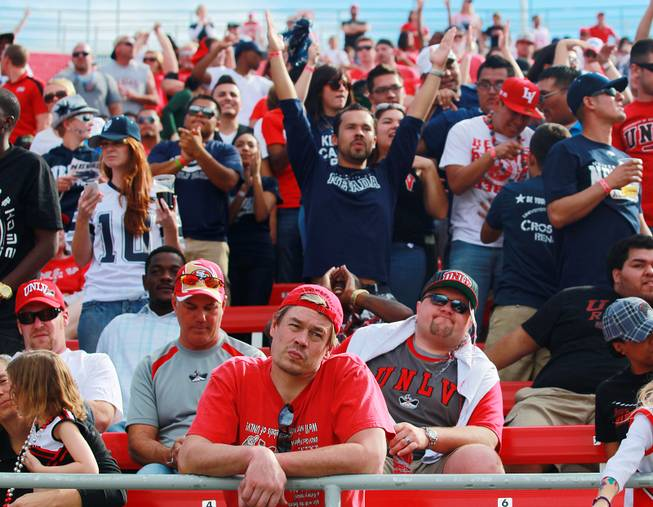 UNLV fans look despondent while UNR fans celebrate after UNR scored to put the game out of reach Saturday, Oct. 13, 2012 at Sam Boyd Stadium. UNR came from behind and won the game, for the eighth consecutive time, 42-37.