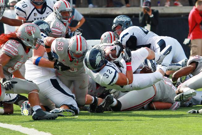 UNR running back Nick Hale dives for a fourth down conversion during their game against UNLV Saturday, Oct. 13, 2012 at Sam Boyd Stadium. UNR came from behind and won the game, for the eighth consecutive time, 42-37.