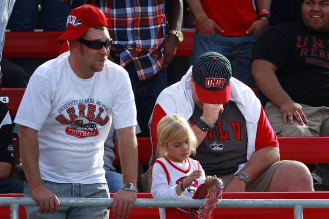 UNLV fans react to UNR's go-ahead touchdown during their game Saturday, Oct. 13, 2012 at Sam Boyd Stadium. UNR came from behind and won the game, for the eighth consecutive time, 42-37.