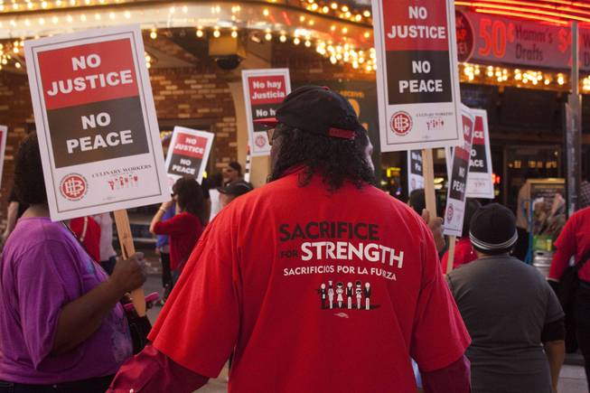 Culinary Workers Union Local 226 members spread out to each of the nine casinos in downtown Las Vegas to protest for health and retirement benefits on Saturday.