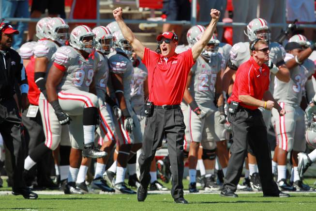 UNLV coach Bobby Hauck celebrates a touchdown against UNR during the first half of their game Saturday, Oct. 13, 2012 at Sam Boyd Stadium.
