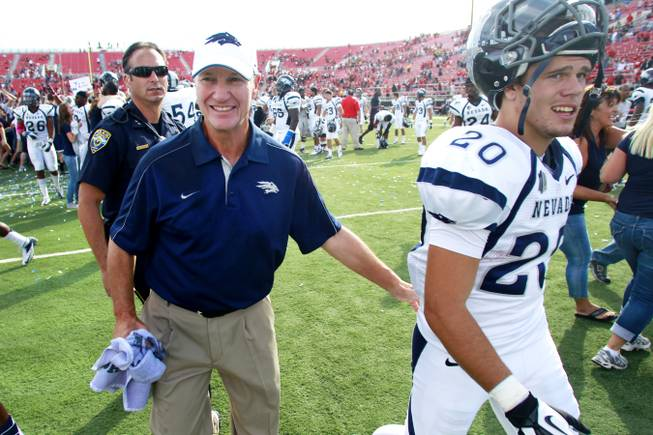 UNR coach Chris Ault walks off the field after defeating UNLV 42-37 Oct. 13, 2012. Ault announced on December 28, 2012 that he would be stepping down after 28 years at the Wolf Pack helm.