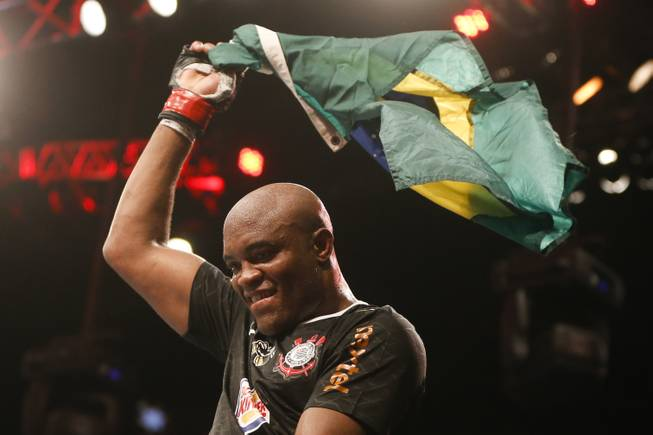 Anderson Silva, from Brazil, celebrates after defeating Stephan Bonnar, from the United States, during their light heavyweight mixed martial arts bout at UFC153 in Rio de Janeiro, early Sunday, Oct. 14, 2012.
