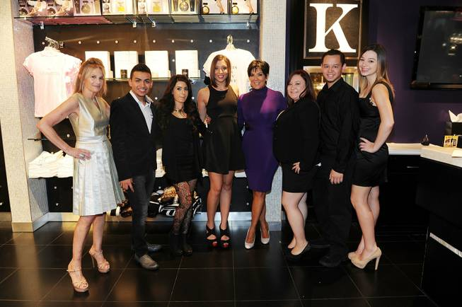 Kris Jenner, fourth from right, attends her
