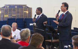 Candidates for the state's 4th Congressional District Steven Horsford, left, and Danny Tarkanian try to talk at the same time doing a debate at Temple Sinai of Las Vegas in Summerlin Sunday, Oct. 14, 2012. The temple's Men's Club sponsored the debate.