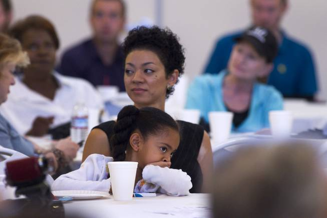 Ella Horsford, 5, sits on her mothers lap as she listens to her father Steven Horsford debate with Danny Tarkanian debate at Temple Sinai of Las Vegas in Summerlin Sunday, Oct. 14, 2012. The temple's Men's Club sponsored the debate.