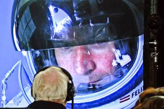 In this image provided by Red Bull, pilot Felix Baumgartner of Austria seen in a screen at mission control center in the capsule during the final manned flight for Red Bull Stratos in Roswell, New Mexico October 14, 2012.