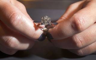 An engagement ring is displayed at Tiffany and Co. in the Crystals retail mall Monday, Oct. 15, 2012. The ring, with a 3.45 carat, D color, internally flawless diamond, retails for $488,500.00.