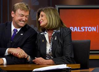 Dean Heller and Shelley Berkley, candidates for Nevada's U.S. Senate seat, shake hands after a debate on the