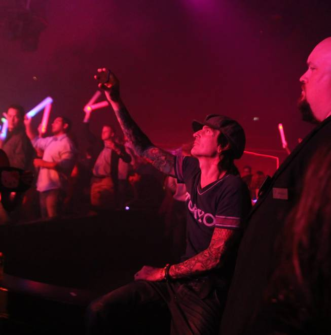 Tommy Lee watches his girlfriend Sofi perform at Rain in the Palms on Saturday, Oct. 13, 2012.