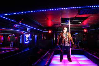 Palomino Club owner Adam Gentile poses inside the North Las Vegas strip club decorated for Halloween on Wednesday, Oct. 17, 2012.