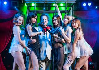 David King, center, CEO of Spirit Productions, poses with dancers from his third show in Las Vegas at the New York-New York called