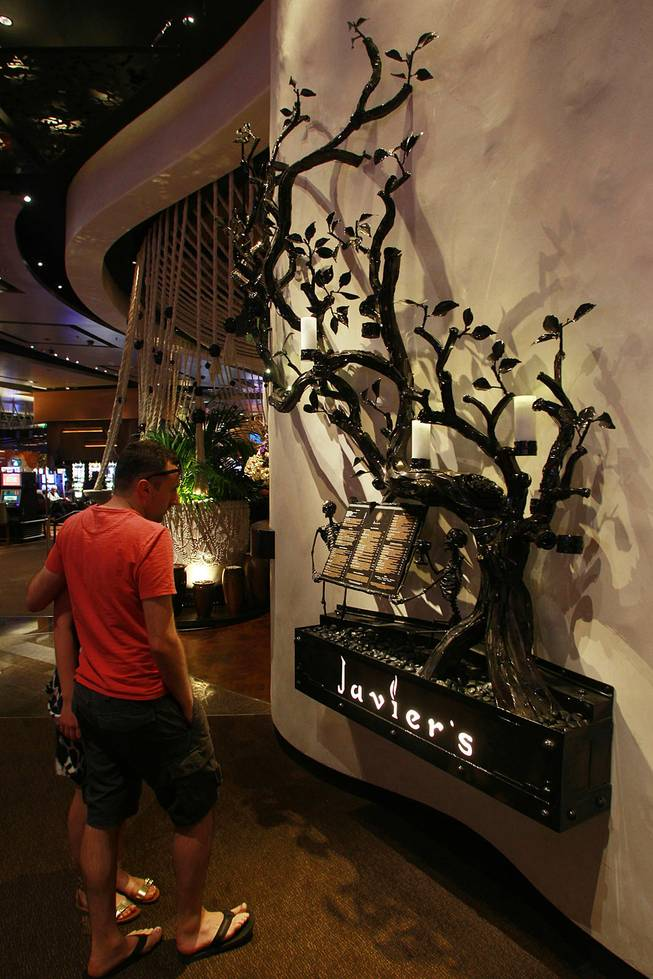 Skeletons hold the menu board at Javier's in Aria Oct. 18, 2012.