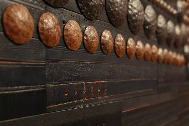 Old leather belts are part of the exterior design of Javier's in Aria Oct. 18, 2012.