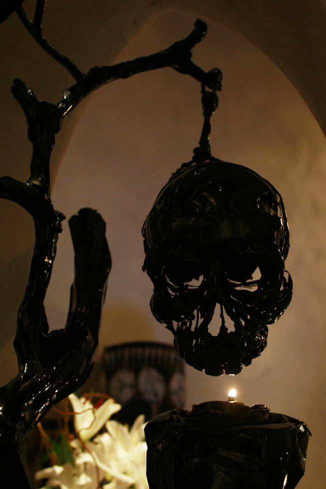 A skull hangs over a candle at Javier's in Aria Oct. 18, 2012.