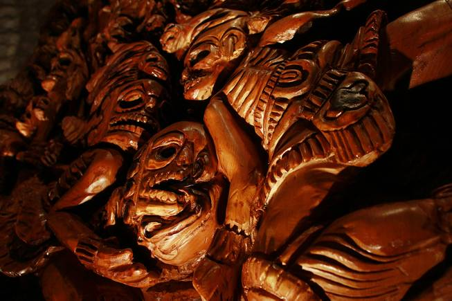 A detail of the chainsaw-carved wood panel at Javier's in Aria Oct. 18, 2012.