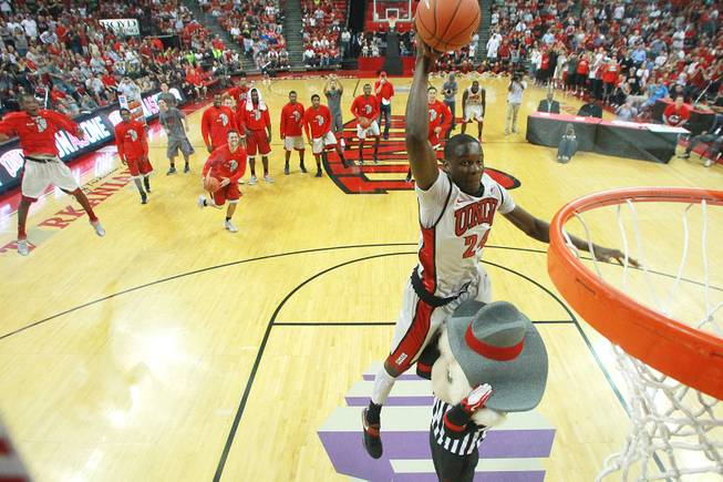 UNLV forward Demetris Morant soars leaps over the top of Hey Reb during the dunk contest at the team's First Look scrimmage Thursday, Oct. 18, 2012 at the Thomas & Mack.