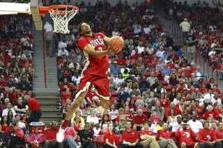 UNLV forward Khem Birch soars to the hoop during the dunk contest at the team's First Look scrimmage Thursday, Oct. 18, 2012, at the Thomas & Mack Center.