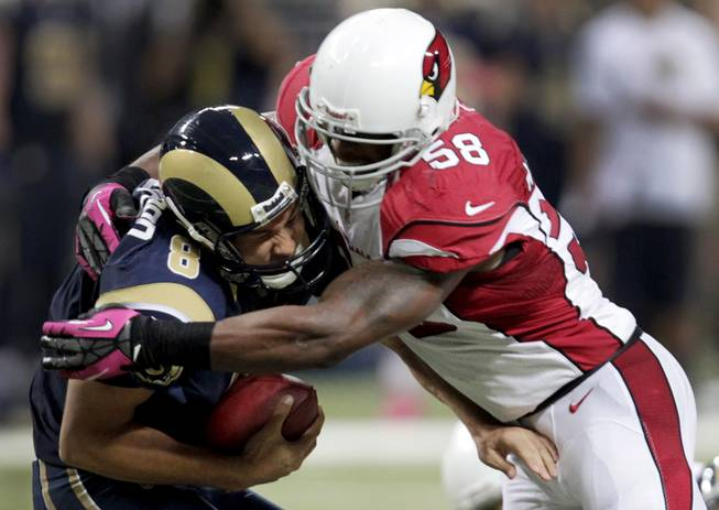 Arizona Cardinals inside linebacker Daryl Washington sacks St. Louis Rams quarterback Sam Bradford during the second quarter of an NFL football game, Thursday, Oct. 4, 2012, in St. Louis.