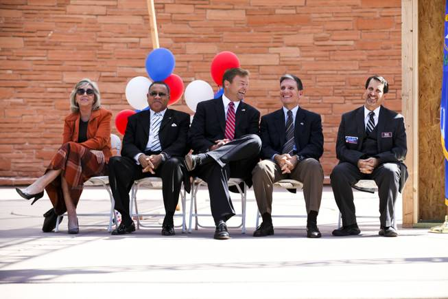 From left, Former Rep. Dina Titus, Rev. Raymond Giddens, senior of the Unity Baptist Church, Sen. Dean Heller, Rep. Joe Heck and Nat Hodgson, executive director of the Southern Nevada Homebuilders Association, wait to address a homeownership rally at the Clark County Government Center Amphitheater Thursday, Oct. 18, 2012.