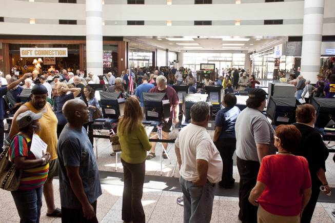 Voters wait in line on the first day of early voting at Boulevard Mall, Saturday, Oct. 20, 2012.