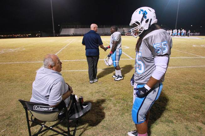Canyon Springs lineman Fabian Leos talks with line coach   Tom Depuit.