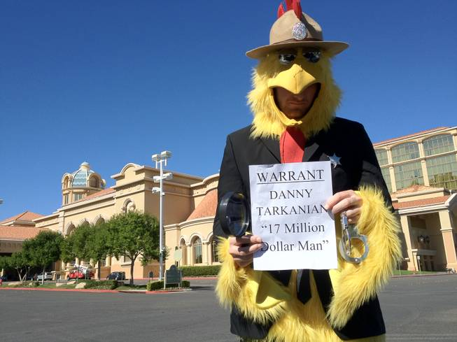 "Paul Smith, of the Nevada Democratic Party, wears a ""U.S. Marshal chicken"" suit to draw attention to the debt of Danny Tarkanian, a Republican candidate for the 4th Congressional District, and Tarkanian's failure to attend a discussion session with the Las Vegas Latin Chamber of Commerce on Friday at the Suncoast Hotel and Casino."