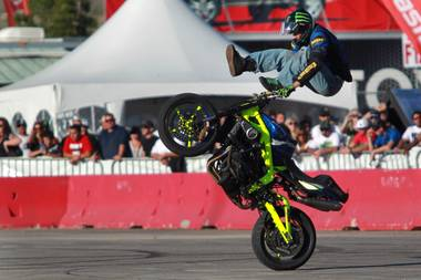 Freestyle motorcycle rider Nick Brocha performs in the parking lot of Sam Boyd Stadium during the Monster Energy Cup on Saturday, Oct. 20, 2012.