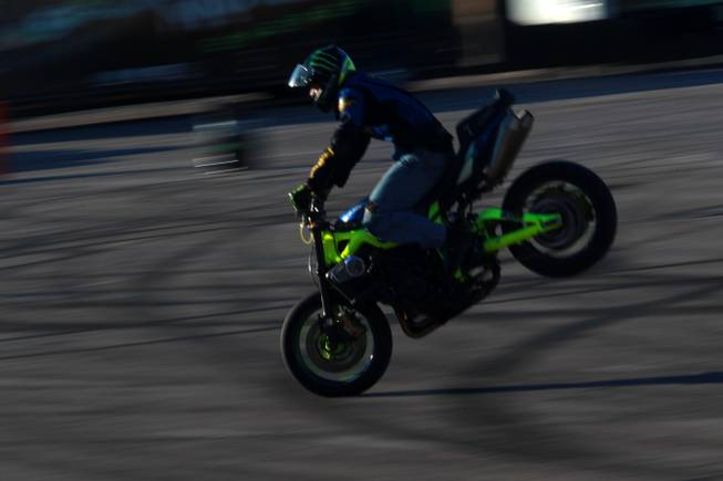 Freestyle motorcycle rider Nick Brocha performs in the parking lot of Sam Boyd Stadium during the Monster Energy Cup Saturday, Oct. 20, 2012.