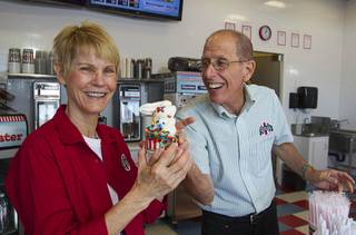 Owners Robin and Irving Dobbs pose with frozen custard at Rita's Green Valley, a custard and Italian ice shop in Henderson, Sunday, Oct. 21, 2012. Rita's, on Stephanie Street just north of Sunset Road, is the first Nevada franchise of a popular East Coast chain that originated in Bensalem Township, Penn.