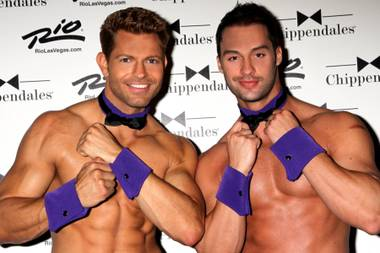 "Jaymes Vaughan and James Davis of Chippendales at the Rio, who are competing in Season 21 of CBS' ""The Amazing Race,"" don purple cuffs and collars on Spirit Day on Friday, Oct. 19, 2012, to combat bullying and support LGBT youth."
