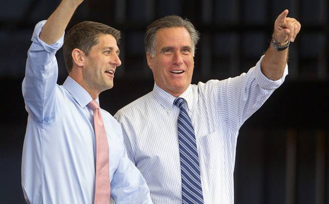 Republican presidential candidate Mitt Romney, right, takes the stage with vice presidential candidate Paul Ryan during a campaign rally at the Henderson Pavilion Tuesday, Oct. 23, 2012.