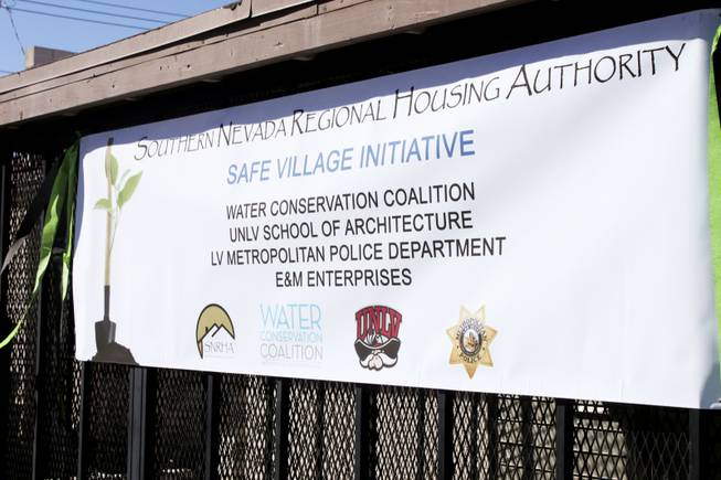 "A banner showing the participants of the Safe Village Initiative is seen during a ""Community Improvement Celebration"" at Sherman Gardens on Wednesday, Oct. 24, 2012. The Sherman Gardens community will be undergoing outdoor renovations as part of a community improvement plan."