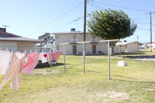 The community clothes lines and backyard area of the Sherman Gardens apartments are seen on Wednesday, Oct. 24, 2012. The Sherman Gardens community will be undergoing outdoor renovations as part of a community improvement plan.