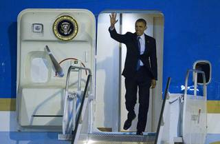 President Barack Obama waves from Air Force One after arriving at McCarran International Airport Wednesday, Oct. 24, 2012.