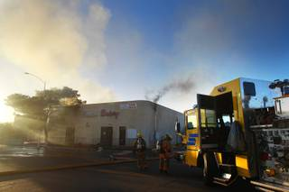 Las Vegas and Clark County fire fighters work a two-alarm fire in an vacant building at Sirius Avenue and Procyon Street Wednesday, Oct. 24, 2012. The fire, which was reported around 6:20 am, gutted the building and no injuries were reported.
