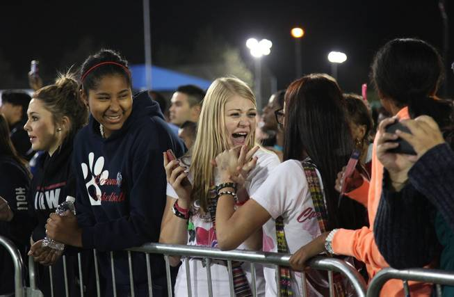 "Elina Motola, 16, screams to her friend Gabriella Benitez, 17 as Katy Perry is announced while Samantha Green, 15 looks on. Benitez described Perry as ""her idol."""