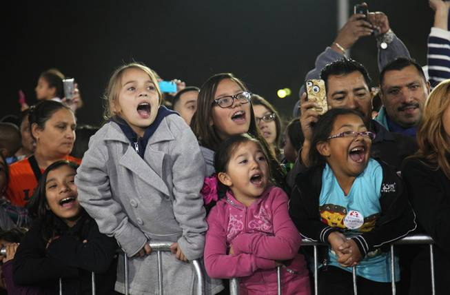"From left to right: Victoria Gonzales, 11, Emma Toledo, 9, Maribel Quezada, 14, Jacquilynn Quevedo, 5 and Izabella Quevedo, 6, sing along to Katy Perry's ""Firework"" at Barack Obama's rally at Doolittle Park Wednesday night, Oct. 24, 2012. They know every word."