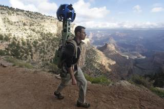 In this Monday Oct. 22, 2012, photo, Google product manager Ryan Falor walks with the Trekker during a demonstration for the media along the Bright Angel Trail at the South Rim of the Grand Canyon National Park in Arizona.