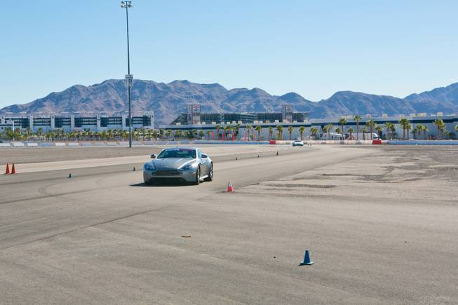 Las Vegas Sun writer John Katsilometes drives the Aston Martin Vantage S on the track at Exotics Racing Las Vegas, Thursday Oct. 15, 2012.