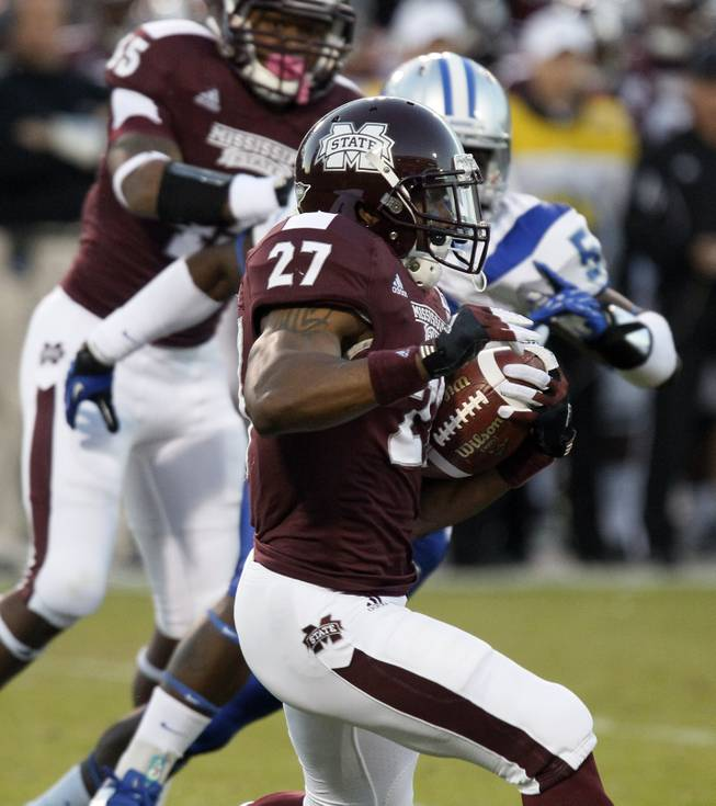 Mississippi State running back LaDarius Perkins (27) rushes past Middle Tennessee linebacker Ykeem Wells (52) for short yardage in the first quarter of an NCAA college football game in Starkville, Miss., Saturday, Oct. 20, 2012.