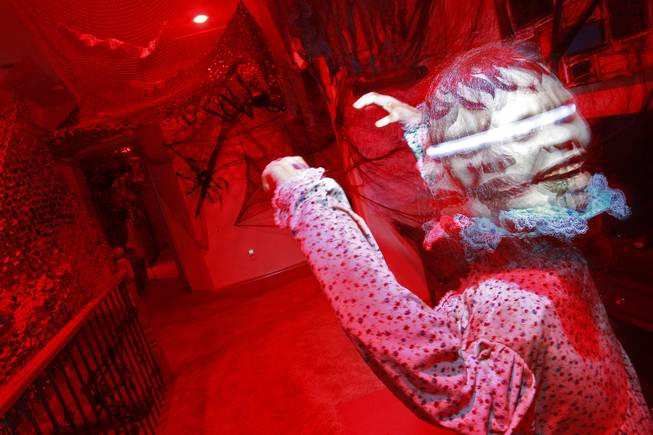 An animatronic child with a spinning head is seen in Vonny and Grant Traub's  house that has been decorated for Halloween Friday, Oct. 26, 2012.